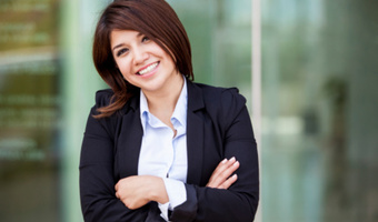 Smiling woman outside office thinkstockphotos