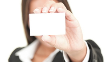 Woman holding blank business card thinkstock