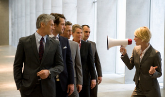 Woman using megaphone at work thinkstock