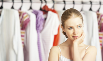 Woman chooses clothes from closet thinkstock