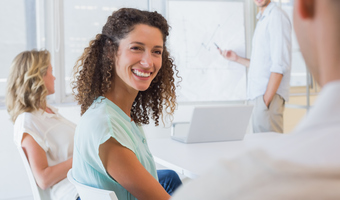 Professional woman smiling at meeting