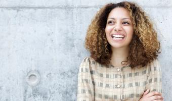 Woman smiling outdoors thinkstock
