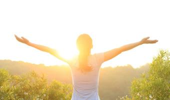 Woman enjoying beautiful sunrise thinkstock