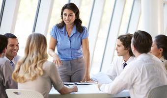 Businesswoman leading meeting thinkstock