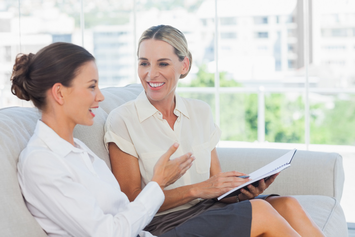 Businesswoman smiling working together thinkstock
