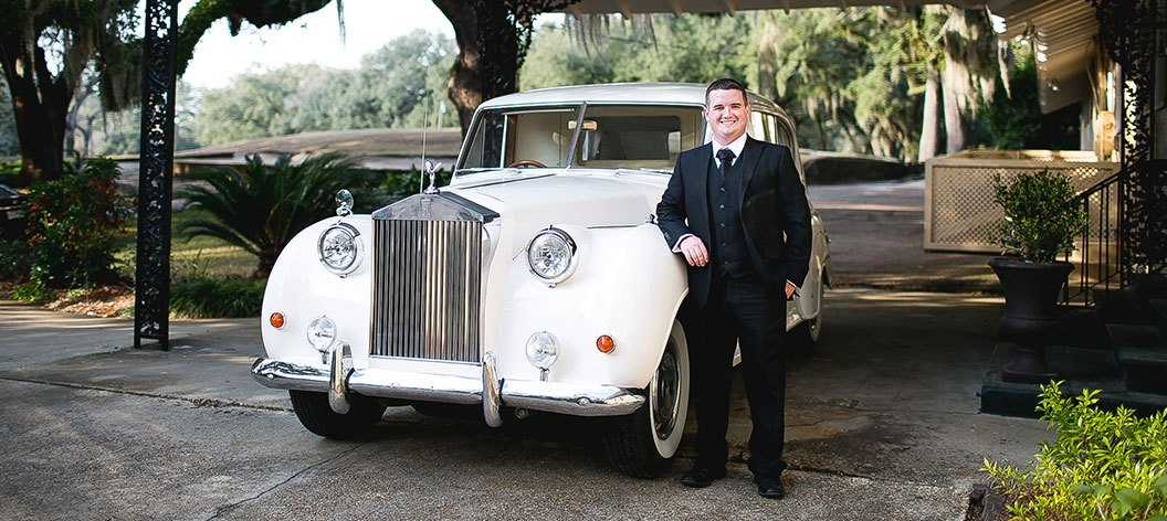 General Manager, Tyler Baker, with our Rolls Royce Limousine