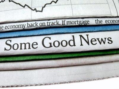 Newspaper with Title Good News Economy