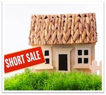 Home with Short Sale Sign in Front Yard