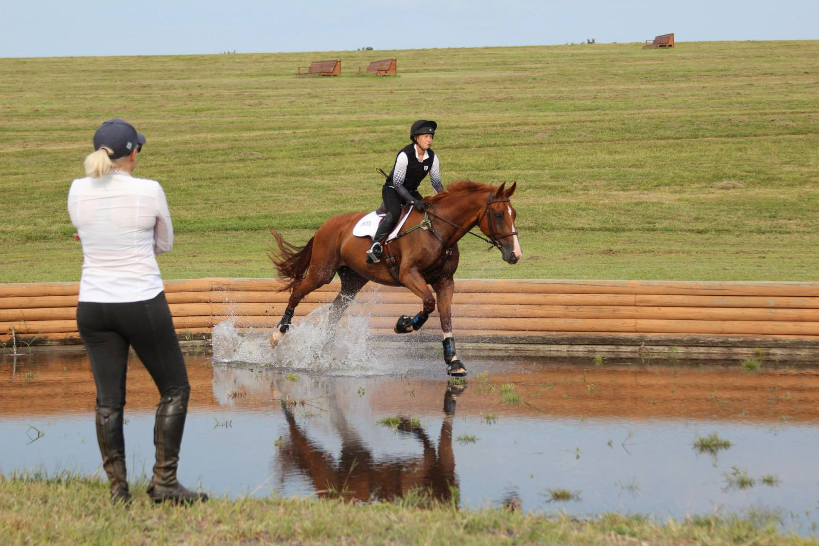 Coaching Amanda Pezold and Beth McDaniel's Alabar through the water complex. Photo by Susan Horner.