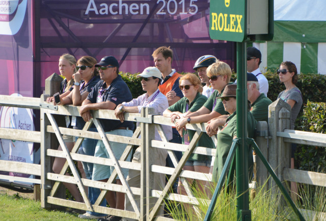 On the left: Super groom Kendyl Tracy, USEF Eventing High Performance Manager Joanie Morris, and U.S. Coach David O'Connor watch Lynn Symansky's show jumping round this afternoon at Aachen. Photo by Jenni Autry.