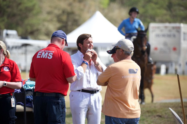 Clayton Fredericks receives medical attention after splitting open his chin this morning. Photo by Rare Air Eventing Photography.