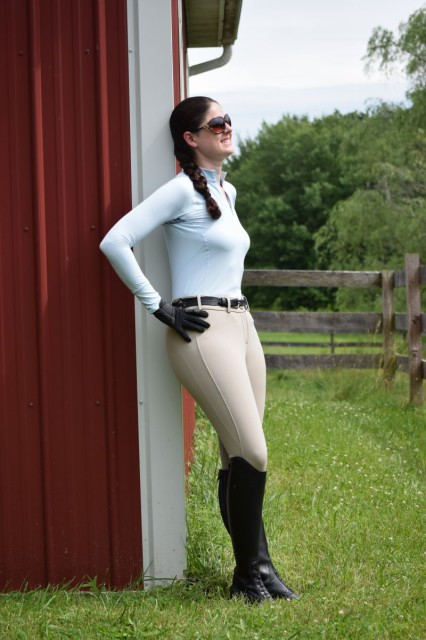 While in the saddle, I feel like the fabric of both the Ashley Performance Shirt and the Signature Breeches are non restrictive and really moves with me. And while being comfortably active, the lightweight fabric also helps by wicking away moisture quickly from my skin. Photo by Lorraine Peachey