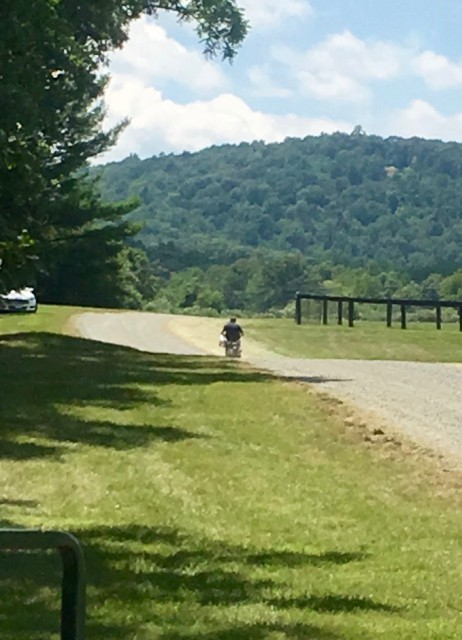 Boyd Martin on a scooter at Great Meadow
