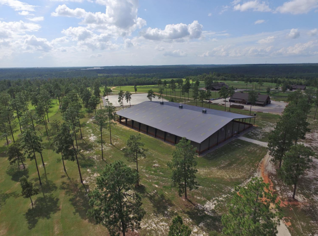 An aerial view of the covered arena, main arena and main barn. Photo courtesy of Stable View.