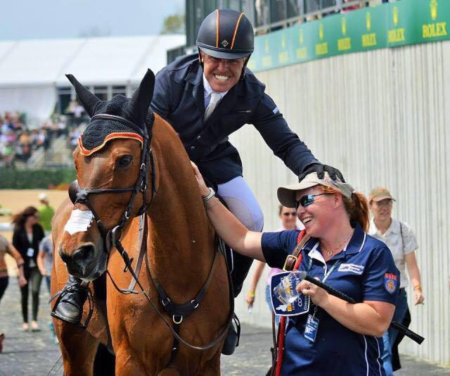 Buck Davidson celebrates a double clear Rolex round with Kathleen Blauth-Murray. Photo by Sally Spickard.