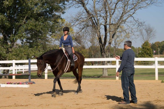Emma's father, Mark Knight, teaching her and their shared horse Beau. Photo courtesy of Emma Knight.