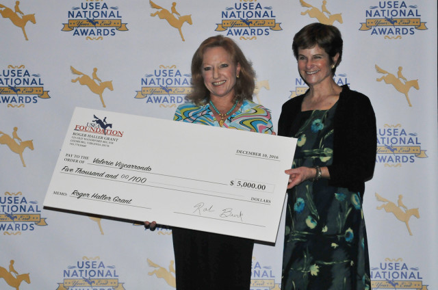 The newly formed Roger Haller Educational Fund was formed to assist in the education and licensing of officials, judges and course designers in honor of the late Roger Haller. The Fund awarded its first two scholarships last night to Valerie Vizcarrondo and John Williams. Roger Haller's wife Ann presented these awards with USEA President Carol Kozlowski. Photo by Leslie Threlkeld.