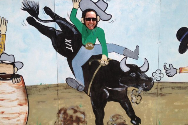 BE-riding-bull-sign