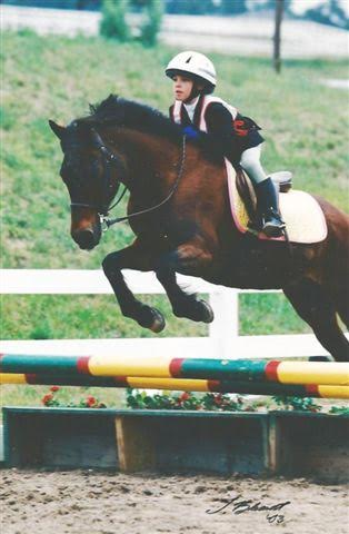 "Madeline at age 7 with her ""wild colored saddle pad"" riding P.S. Mystical Magic. Photo courtesy of Madeline Backus."