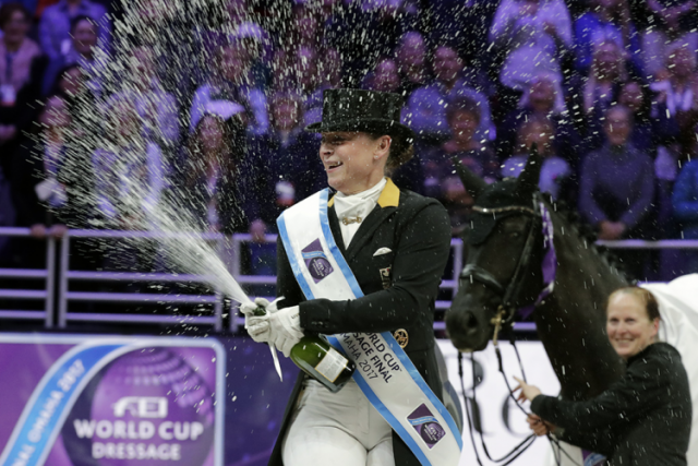 Jubilation on the podium as Isabell Werth celebrates her win watched by her groom Steffi Weigard and her beautiful mare Weihegold at the FEI World Cup Dressage Final 2017 in Omaha. Photo by Jim Hollander/FEI.