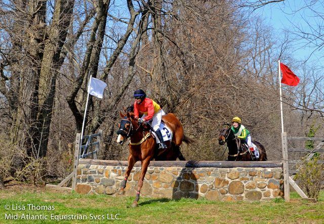 Jennie Brannigan and Joshua G. over the stone wall at Brandywine Hills. Photo by Lisa Thomas.