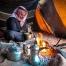 Bedouin man in Wadi Rum grinding coffee - Jordan tour