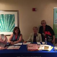 Laureen Fleck, Gail Fox-Seaman and Jean Aertker Sit the PAC Table a the FNPN Conference