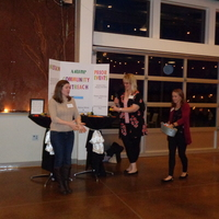 Natalie Mohammad  left and Community Outreach coordinators Melissa Moran and Amanda Meyer drawing for door prizes