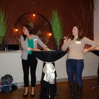 Drawing for door prizes past-president Cecelia Engler and current president Natalie Mohammad.