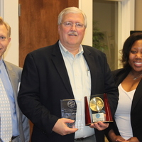 """Dr Perry Kemp accepting the 2015 UAPRN State APRN Advocate Award from Drs. Michelle Nelson and James Lawrence""."