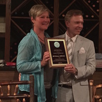Epitomizing style, grace, and class like few others, Jill Nielson, UAPRN chapter president of North Georgia Mountain accepts the 2015 state leadership award presented to her by state president James Lawrence.