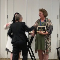 Lynn Rapsilber, DNP, ANP-BC, FAANP & Laima Karosas, PhD, ANP-BC, FAANP presenting Elizabeth M. Visone, DNP, ANP-BC, FNP-BC, FAANP with the 2019 AANP State Award for Excellence and the award for CTAPRN of the year at the CTAPRNS annual conference.