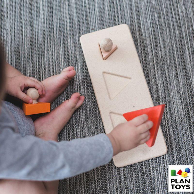 Encaje triángulos con tarugo de madera