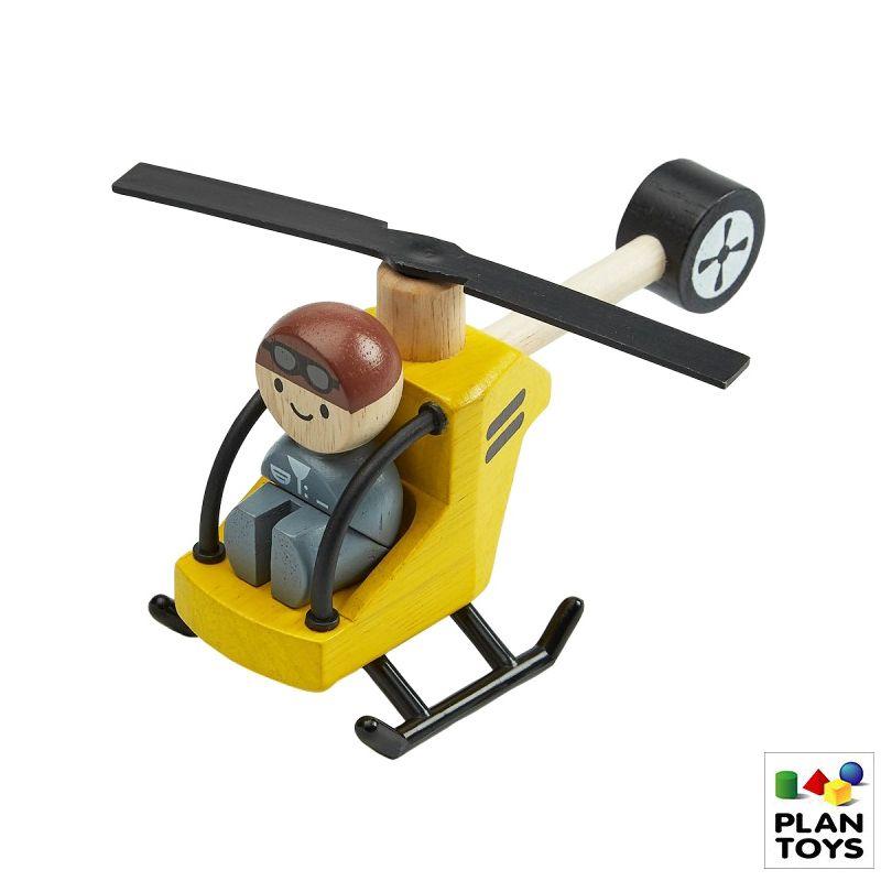 Helicoptero con piloto de madera