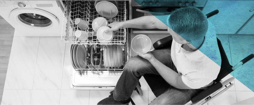 Disabled person loading a dishwasher