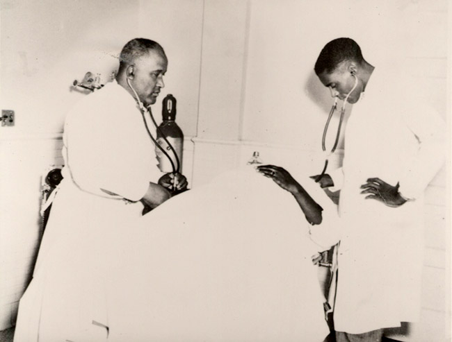 Cleon Flowers and C. A. Lawlah with Patient