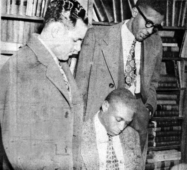 Silas Hunt (seated); Wiley Branton (standing left); and Harold Flowers