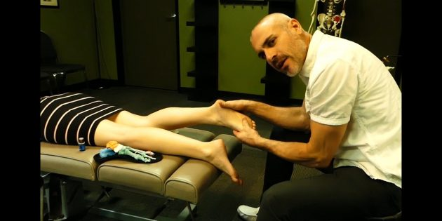 picture of Dr. Dave applying Panaway essential oil to the right foot of a patient lying prone