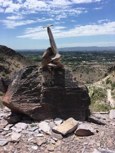 stacked stones in balance at top of piestewa peak phoenix az