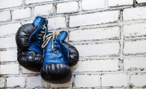 boxing gloves hanging with brick wall background