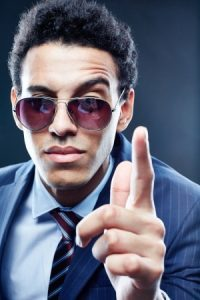 Man with pointer finger raised in a stern manner