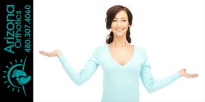woman with arms up in arm suggesting she is weighing her options