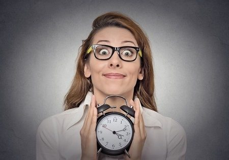 Woman holding clock in hopes of what's to come