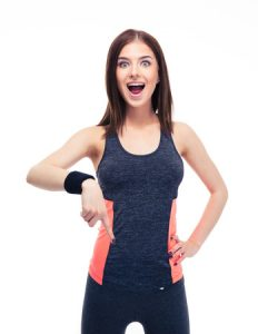 Woman in athletic clothing pointing down