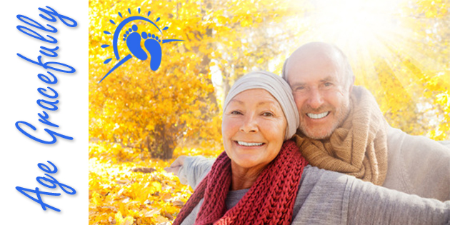 Elderly Couple Smiling in Autumn Leaves colored yellow