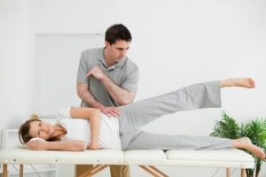 physical therapy working on the hip of a side-lying patient