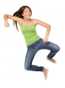 happy woman jumping up into the air