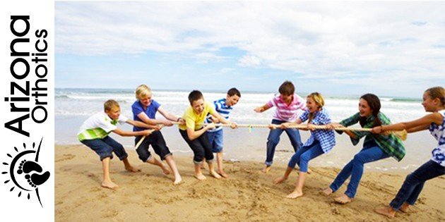 tug of war between friends on beach