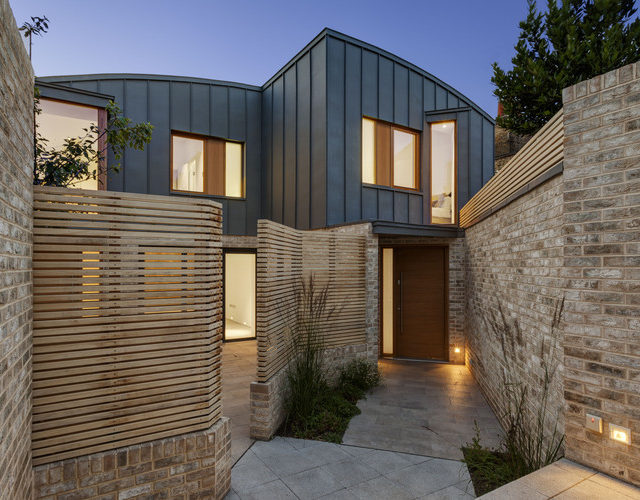 The_entrance_courtyard_to_the_two_houses_at_dusk_-_Bruce_Hemming