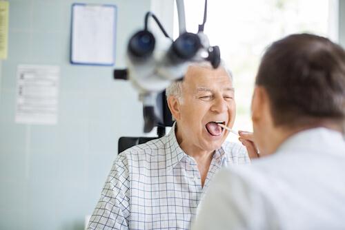Man receiving Tonsillectomy exam